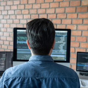 Young Professional programmer working at developing programming